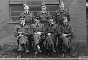 ROYAL AIR FORCE BOMBER COMMAND, 1942-1945. (HU 92988) The Acting Commanding Officer of No. 44 Squadron RAF, Squadron Leader J D Nettleton (sitting, second from left) and his crew, photographed on their return to Waddington, Lincolnshire, after leading the low-level daylight attack on the M.A.N. diesel engineering works at Augsburg on 17 April 1942. For his courage and leadership during the raid Nettleton was gazetted for the award of the Victoria Cro... Copyright: © IWM. Original Source: http://www.iwm.org.uk/collections/item/object/205127125