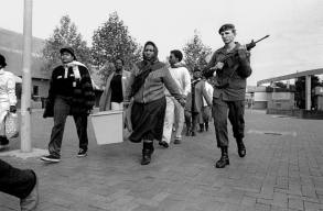 SADF member escorts a 1994 general election ballot box under armed guard