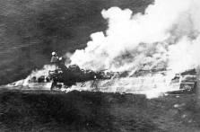 HMS Hermes ablaze and sinking